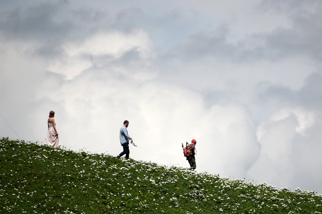 People are seen at the Krasnaya Polyana ski resort in Sochi, Russia on June 15, 2020. On June 15, the resort opened a snow park for skiers and snowboarders at the Tsirk-2 (Circus-2) mountain valley, as well as all cableways leading to the top of Mount Black Pyramid. (Photo by Dmitry Feoktistov/TASS)