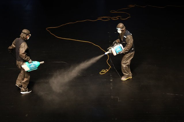 Disinfection workers wearing protective clothing spray anti-septic solution in an Sejong Culture Center, M-Theatre amid concerns over the spread of coronavirus on July 21, 2020 in Seoul, South Korea. With the number of daily local cases recently hovering around 20 or below, but imported cases continued to rise by double digit figures. South Korea resumed operations of some museums and libraries in the greater Seoul area starting yeaterday. Health authorities, however, are still vigilant over the spread of the virus in vacation spots over the summer, pointing out that the season will serve as a critical juncture for the nation's anti-virus fight. The country added 45 cases toddy, including 20 local infections, raising the total caseload to 13,816, according to the Korea Centers for Disease Control and Prevention (KCDC). (Photo by Chung Sung-Jun/Getty Images)