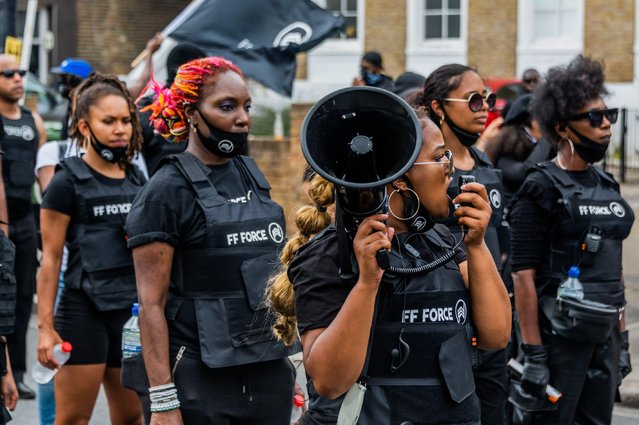 """Black Live Matter march from Clapham Common (led by Iman, the Forever Family Force and the Slow Boys, on motorbikes) to join the Stop the Maangamizi: Afrikan Emancipation Day Reparations Rebellion in London, UK on August 1, 2020. They aim to lock-down Brixton because """"WE/they are not being HEARD"""" in their demand for the UK Government to establish the All-Party Parliamentary Commission of Inquiry for Truth & Reparatory Justice. (Photo by Guy Bell/Alamy Live News)"""