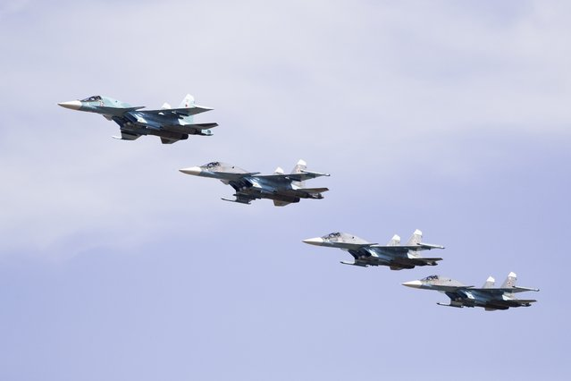 Russian military Su-34 bombers fly during military drills at the Black Sea coast, Crimea, Friday, September 9, 2016. (Photo by Pavel Golovkin/AP Photo)
