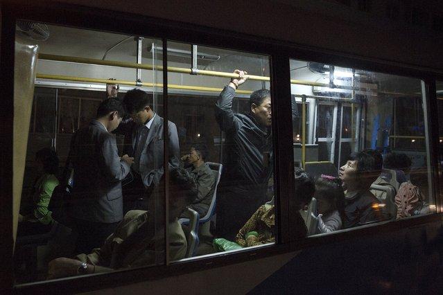 People take a public bus in Pyongyang late October 7, 2015. (Photo by Damir Sagolj/Reuters)