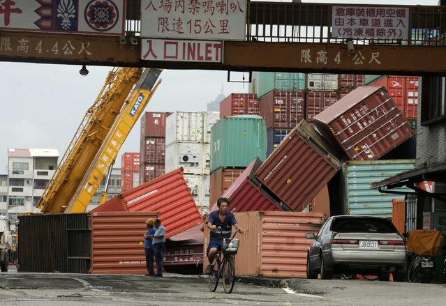 Fallen cargo containers caused by super typhoon Meranti in Kaohsiung city, southern Taiwan, 15 September 2016. (Photo by Ritchie B. Tongo/EPA)