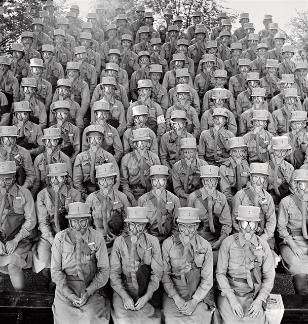 "Members of the Women's Auxiliary Army Corps, commonly known as WAACs, don their first gas masks at Fort Des Moines, Iowa, in June 1942. The female troops were famously praised by General Douglas MacArthur, who called them ""my best soldiers"". (Photo by Marie Hansen/Time & Life Pictures)"