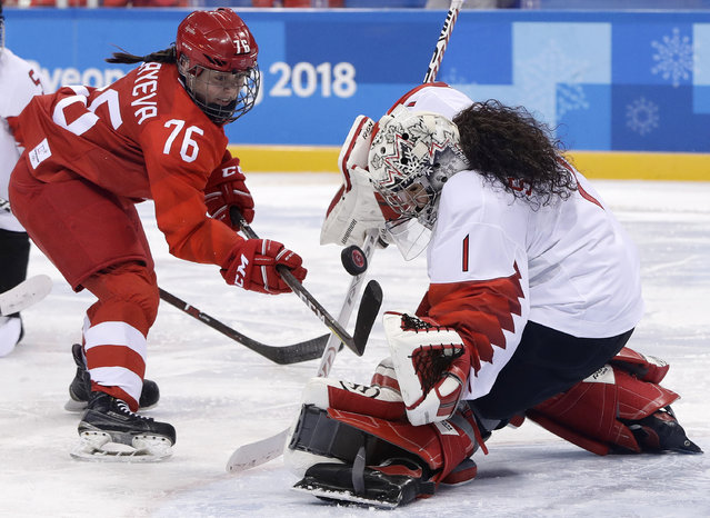 Goalie Shannon Szabados (1), of Canada, deflects a shot by Russian athlete Yekaterina Nikolayeva (76) during the second period of the semifinal round of the women's hockey game at the 2018 Winter Olympics in Gangneung, South Korea, Monday, February 19, 2018. (Photo by Matt Slocum/AP Photo)