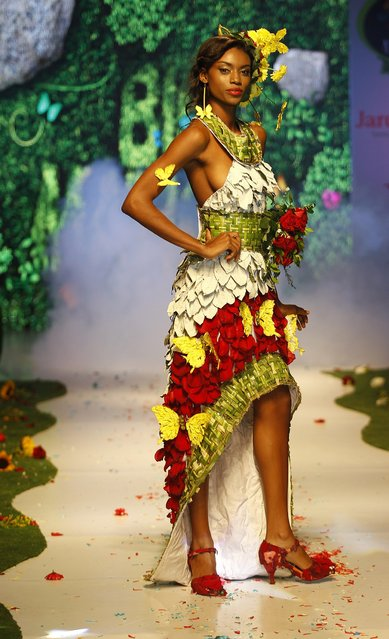 A model presents a creation during the Biofashion show in Cali, Colombia, on November 29, 2014. The designs are made from plants, recycled and natural materials. (Photo by Jaime Saldarriaga/Reuters)