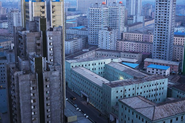 A view of central Pyongyang, North Korea, at dusk on April 12, 2011. (Photo by David Guttenfelder/AP Photo)