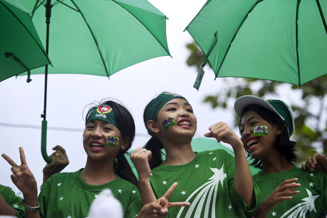 Singers perform on a motorcade during a campaign rally by supporters of the army-backed ruling Union Solidarity and Development Party (USDP) in Yangon on October 30, 2015. The once junta-run nation heads to the polls on November 8 in what voters and observers hope will be the freest election in decades. (Photo by Ye Aung Thu/AFP Photo)