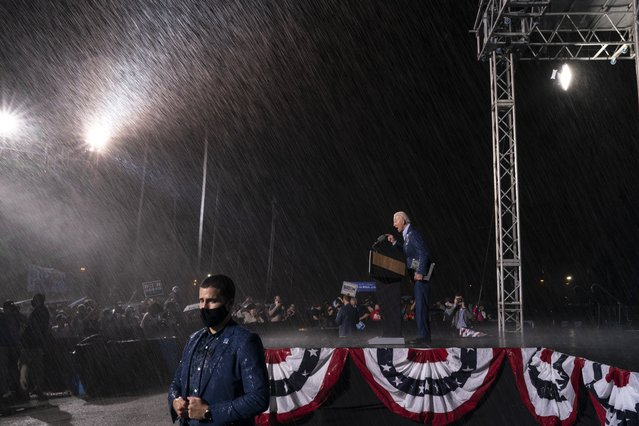 Democratic presidential nominee Joe Biden concludes his remarks as a downpour begins during a drive-in campaign rally at the Florida State Fairgrounds on October 29, 2020 in Tampa, Florida. Biden is campaigning in Florida on Thursday, with drive-in rallies in Tampa and Broward County. (Photo by Drew Angerer/Getty Images)