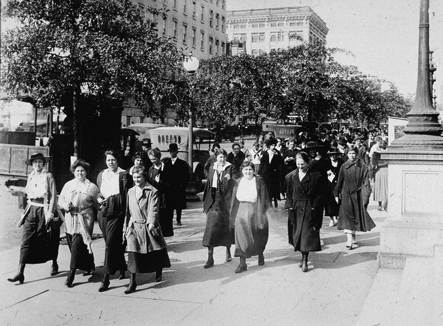 Women from the Department of War take 15-minute walks to breathe in fresh air every morning and night to ward off the influenza virus during World War I, circa 1918. (Photo by Hulton Archive/Getty Images)