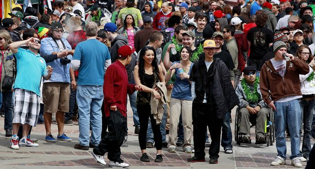 Crowds begin to gather at the Denver 4/20 pro-marijuana rally at Civic Center Park in Denver on Saturday, April 20, 2013. Authorities generally look the other way at public pot smoking here on April 20. Police said this week they're focused on crowd security in light of attacks that killed three at the finish line of the Boston Marathon. (Photo by Brennan Linsley/AP Photo)