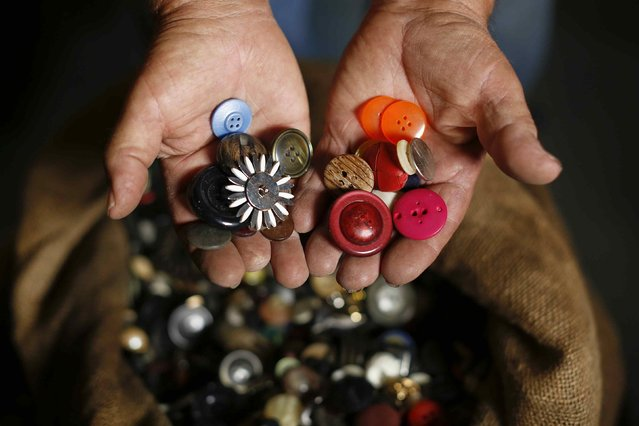 Italian collector Domenico Agostinelli holds buttons in his museum in Dragona, near Rome November 6, 2014. 74-year-old has a passion that has led him over the past 60 years to pick up and collect things of all types, from antique art to everyday objects of the past and present. (Photo by Tony Gentile/Reuters)