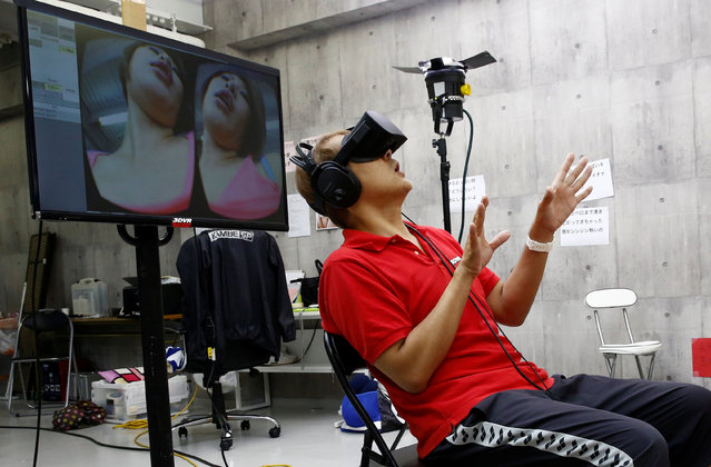 Director Taro Kambe directs as he watches acting with VR headset during a rehearsal for ROCKET's 3D virtual reality adult film at the company's studio in Tokyo, Japan, July 31, 2017. (Photo by Kim Kyung-Hoon/Reuters)