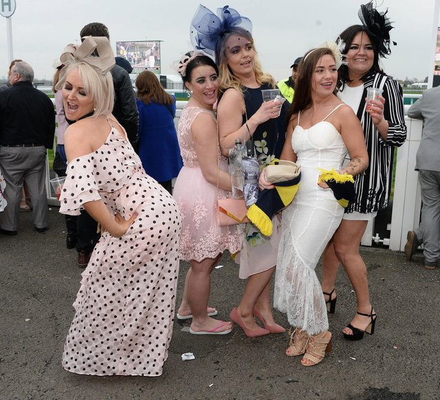 Racegoers attend day one of The Randox Health Grand National Festival at Aintree Racecourse on April 12, 2018 in Liverpool, England. (Photo by News Group Newspapers Ltd)