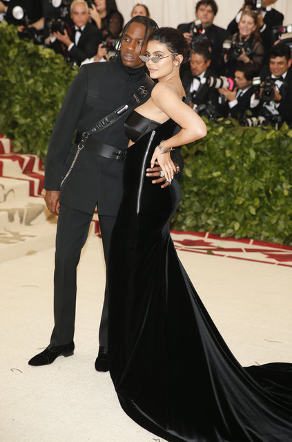 Travis Scott and Kylie Jenner attend The Metropolitan Museum of Art's Costume Institute benefit gala celebrating the opening of the Heavenly Bodies: Fashion and the Catholic Imagination exhibition on Monday, May 7, 2018, in New York. (Photo by Carlo Allegri/Reuters)