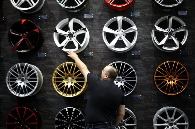 A visitor looks at car rims at the Essen Motor Show in Essen, Germany, November 27, 2015. (Photo by Ina Fassbender/Reuters)