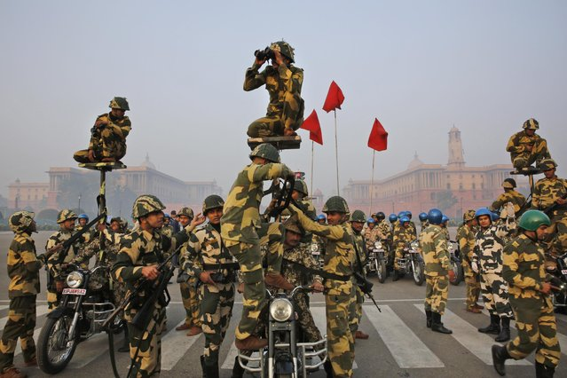 A Daredevils unit of the Indian Border Security Force prepares to perform during rehearsals for the upcoming Republic Day parade in New Delhi, India, Thursday, January 14, 2015. (Photo by Manish Swarup/AP Photo)