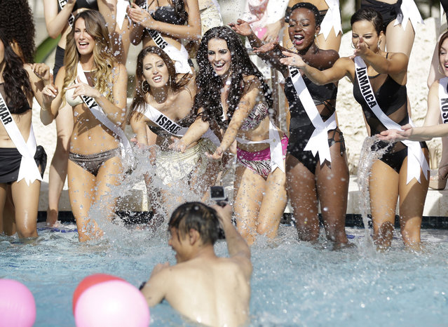 Miss Universe contestants Valentina Bonariva, of Italy, left, Doron Matalon, of Israel, Marcela Chmielowska, of Poland, Gaylyne Ayugi, of Kenya, and Kaci Fennell, of Jamaica, splash water at a photographer during the Yamamay swimsuit runway show, Wednesday, January 14, 2015, in Doral, Fla. (Photo by Lynne Sladky/AP Photo)