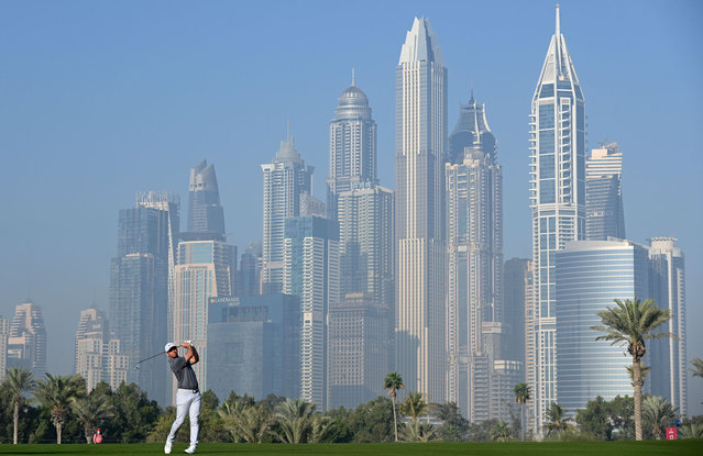 Paul Casey of England plays his second shot on the thirteenth during Day One of the Omega Dubai Desert Classic at Emirates Golf Club on January 28, 2021 in Dubai, United Arab Emirates. (Photo by Ross Kinnaird/Getty Images)