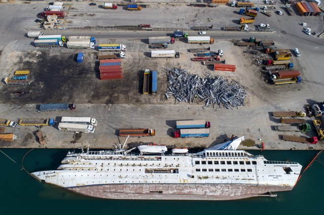 A picture taken with a drone shows a capsized ship lying on its side at the destroyed port area at the six months mark since the day of the explosion, in Beirut, Lebanon, 03 February 2021. At least 200 people were killed, and more than six thousand injured in the Beirut blast that devastated the port area on 04 August. It is believed to have been caused by an estimated 2,750 tons of ammonium nitrate stored in a warehouse. (Photo by Wael Hamzeh/EPA/EFE)
