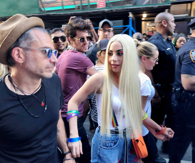 Lady Gaga and Christian Carino are seen at the 2018 New York City Pride March on June 24, 2018 in New York City. (Photo by Richard Stabler/Getty Images)