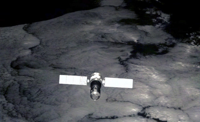 China's Shenzhou-7 spaceship, viewed by a small monitoring satellite six seconds after it was released from the spaceship on Sept. 27, 2008. Launched about two hours after Chinese astronaut Zhai Zhigang finished the country's first spacewalk, the monitoring satellite has sent back over 1,000 pictures of the spaceship, Xinhua said. (Photo by AP Photo/Xinhua via The Atlantic)