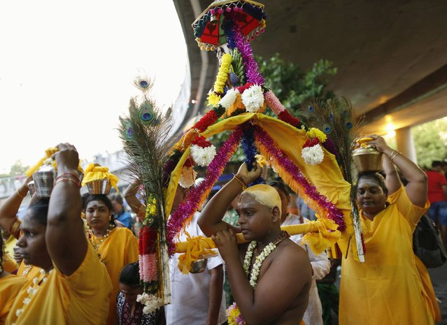 A Hindu devotee carries a kavadi on his pilgrimage to the Batu Caves temple during Thaipusam in Kuala Lumpur February 2, 2015. (Photo by Olivia Harris/Reuters)