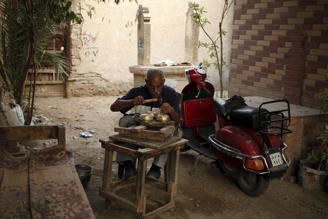 A man works in an alley inside the Cairo Necropolis, Egypt, September 17, 2015. (Photo by Asmaa Waguih/Reuters)