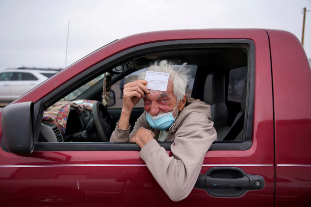Taras Mychalewych, 75, poses for a portrait with his vaccination card after receiving his coronavirus disease (COVID-19) vaccine at a rural vaccination site in Columbus, New Mexico, U.S., April 16, 2021. (Photo by Paul Ratje/Reuters)