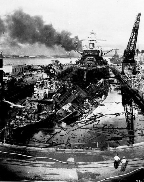 The destroyers USS Downes and USS Cassin lie wrecked in Drydock One ahead of the battleship USS Pennsylvania soon after the end of the Japanese air attack on Pearl Harbor, Hawaii, U.S. December 7, 1941.  The 75th anniversary of the attack, which brought the United States into World War Two, is marked on December 7, 2016. (Photo by Navy Photographer's Mate Harold Fawcett/Reuters/U.S. Navy/National Archives)