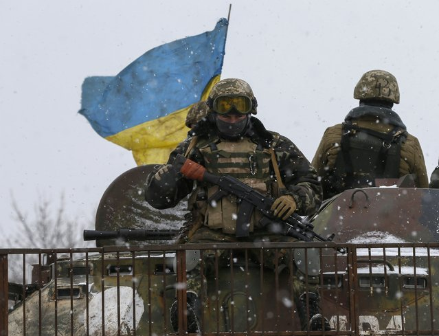 Members of the Ukrainian armed forces ride on a military vehicle near Debaltseve, eastern Ukraine February 16, 2015. (Photo by Gleb Garanich/Reuters)