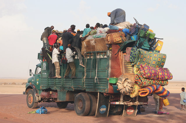 Truck in Mopti, Mali. The difference between supercharged and overloaded might often be close, but we could learn a lot of the endless African creativity in loading cargo on automobiles, bikes or donkey charts. (Photo and caption by Ferdinand Reus)