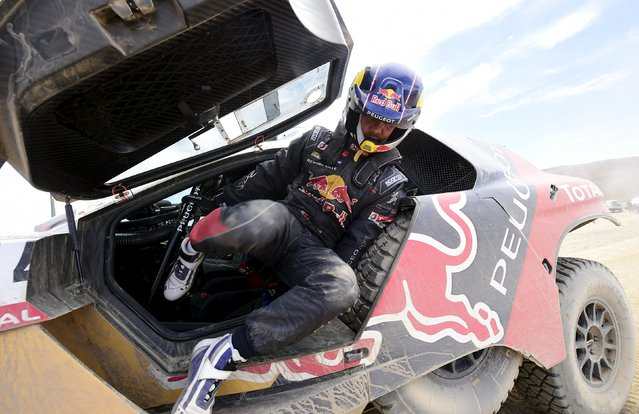 Sebastien Loeb of France gets out of his Peugeot at the end of the sixth stage in the Dakar Rally 2016 near Uyuni, Bolivia, January 8, 2016. (Photo by Frank Fife/Reuters)