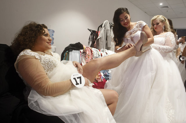 """Contestants seen preparing at backstage during the """"Miss Ukraine Plus Size"""" beauty pageant in Kiev, Ukraine on October 29, 2018. (Photo by Pavlo Gonchar/SOPA Images via ZUMA Wire)"""