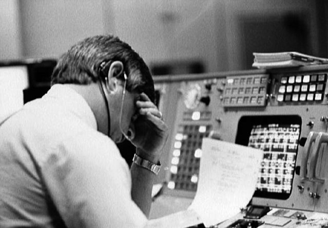 Flight director Jay Greene studies data at his console inside Johnson Space Center's Mission Control Center in Texas, just minutes after the announcement that Challenger's ascent was not nominal. (Photo by NASA)