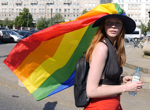 A woman take part in the Equality Parade, the largest gay pride parade in central and eastern Europe, in Warsaw, Poland, Saturday June 19, 2021. (Photo by Czarek Sokolowski/AP Photo)