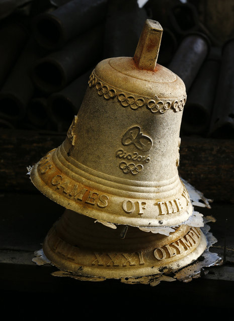 Newly melted bronze bells rest in the workshop of the Blondeau foundry in La Chaux-de-Fonds, Switzerland January 21, 2016. (Photo by Denis Balibouse/Reuters)