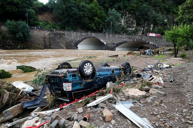 A destroyed car is seen next to the Ahr river, following heavy rainfalls in Schuld, Germany, July 15, 2021. (Photo by Wolfgang Rattay/Reuters)