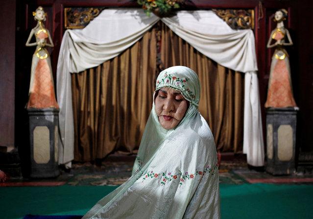 Shinta Ratri, owner of an Islamic boarding school for transgender women, sits in prayer in Yogyakarta, Indonesia, September 23, 2018. (Photo by Kanupriya Kapoor/Reuters)