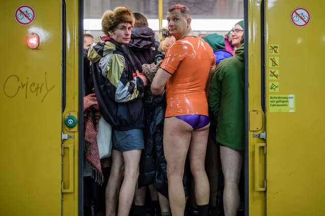 "People wearing no pants participate in the worldwide event ""No Pants Subway Ride"" in Berlin,Germany, January 13, 2019. (Photo by Clemens Bilan/EPA/EFE/Rex Features/Shutterstock)"