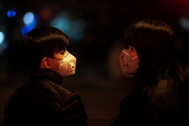 A couple wears masks on a street amid heavy smog in downtown Shanghai, China January 4, 2017. (Photo by Aly Song/Reuters)