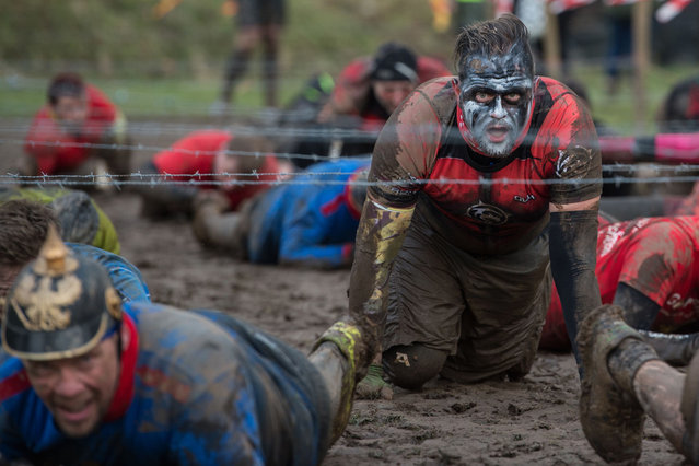 Competitors crawl under barbed wire as they take part in the Tough Guy endurance event near Wolverhampton, central England, on January 27, 2019. (Photo by Oli Scarff/AFP Photo)
