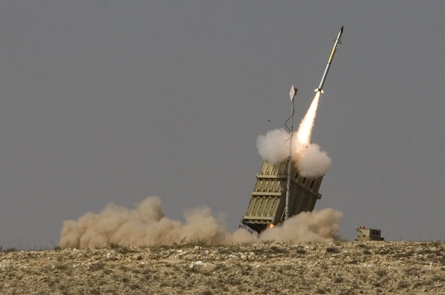 In this August 21, 2011 file photo, a rocket is launched from a new Israeli anti-missile system known as Iron Dome in order to intercept a rocket fired by Palestinian militants from the Gaza Strip, in the southern city of Beersheba, Israel. Twenty five years after the first U.S. Marines swept across the border into Kuwait in the 1991 Gulf War, American forces find themselves battling the extremist Islamic State group, born out of al-Qaida, in the splintered territories of Iraq and Syria. In Israel, the memory of Iraqi Scud missile fire prompted the military to speed up a missile-defense program that included the development of its Iron Dome rocket-defense system with the help of the Americans. (Photo by Dan Balilty/AP Photo)