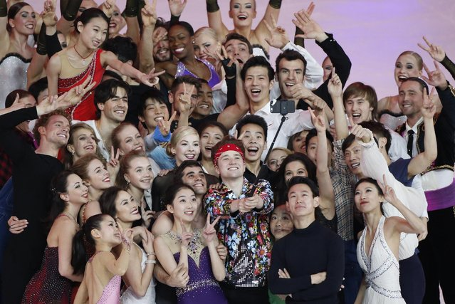 "Skaters in the Exhibition event pose for a ""selfie"" photo in the ISU World Figure Skating Championship 2015 held at the Oriental Sports Center in Shanghai, China, Sunday, March 29, 2015. (Photo by Ng Han Guan/AP Photo)"