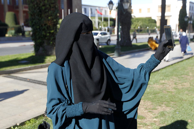 A niqab-wearing Salafist protester takes a selfie as she attends a demonstration against the ban on the sale and manufacturing of the full-burqa in Rabat January 15, 2017. (Photo by Reuters/Stringer)