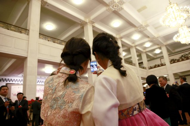 Ethnic Korean delegates take selfies ahead of the opening session of the National People's Congress (NPC) at the Great Hall of the People in Beijing, China, March 5, 2016. (Photo by Kim Kyung-hoon/Reuters)