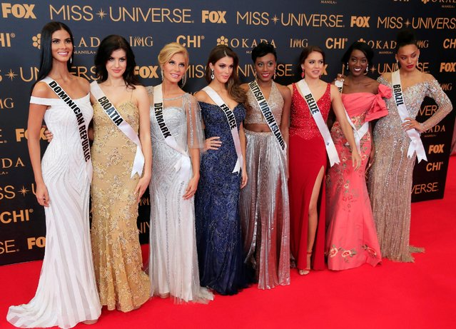 Miss Universe candidates pose for a picture during a red carpet inside a SMX convention in metro Manila, Philippines January 29, 2017. In Photo from L-R: Miss Dominican Republic Rosalba Garcías, Miss Croatia Barbara Filipovic, Miss Denmark Christina Mikkelsen, Miss France Iris Mittenaere, Miss British Virgin Islands Erika Creque, Miss Belize Rebecca Rath, Miss Angola Luísa Baptista and Miss Brazil Raissa Santana. (Photo by Romeo Ranoco/Reuters)