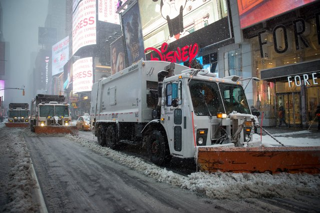 Snowplows move through Times Square during a winter storm, February 9, 2017 in New York. (Photo by Bryan R. Smith/AFP Photo)