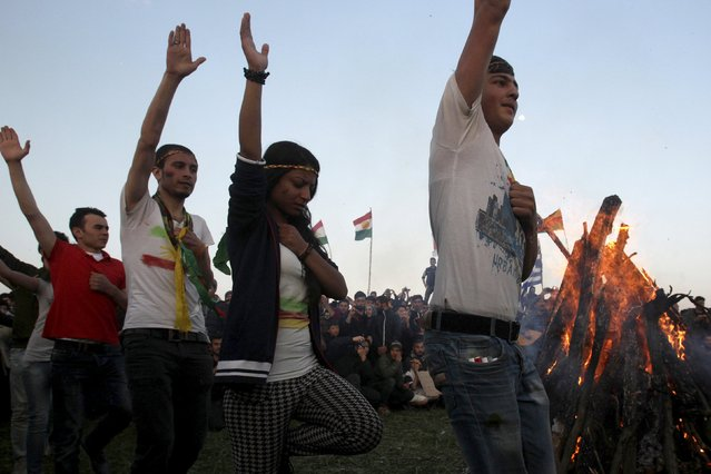 Syrian and Iraqi Kurds celebrate Newroz at a makeshift camp for refugees and migrants near the village of Idomeni, Greece, March 20, 2016. (Photo by Alexandros Avramidis/Reuters)