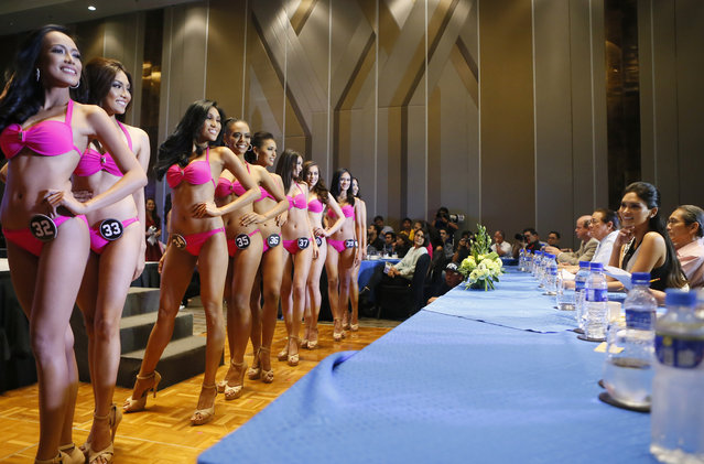 Reigning Miss Universe Pia Wurtzbach,second from right, watches beauty contestants during a media presentation at suburban Quezon city northeast of Manila, Philippines, Tuesday, March 29, 2016. Forty beauty hopefuls are vying for the coveted title that would represent the Philippines in the Miss Universe beauty pageant. (Photo by Bullit Marquez/AP Photo)