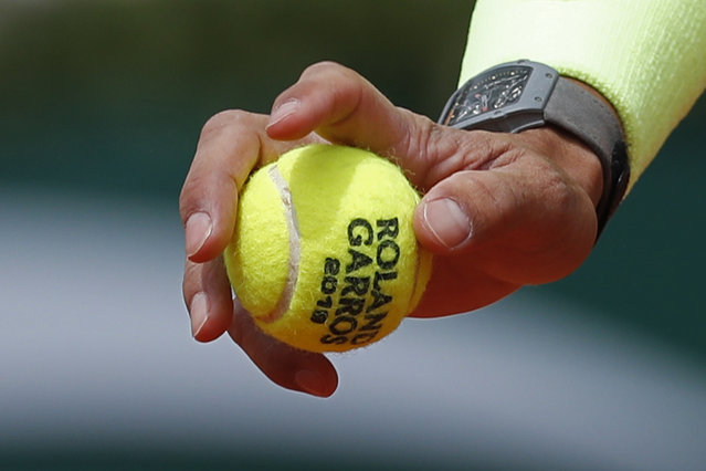 """In this Monday, May 27, 2019, file photo, Spain's Rafael Nadal prepares to serve against Germany's Yannick Hanfmann during their first round match of the French Open tennis tournament at the Roland Garros stadium in Paris. English-speakers tend to go with """"French Open"""", even though that's not used by the event itself. Most of the rest of the world says """"Roland Garros"""", which is the facility that hosts the tournament and is named in memory of a World War I fighter pilot. But what hardly ever is uttered is the original name of the tournament """"Internationaux de France"""", which translates to """"International Championships of France"""". (Photo by Pavel Golovkin/AP Photo/File)"""